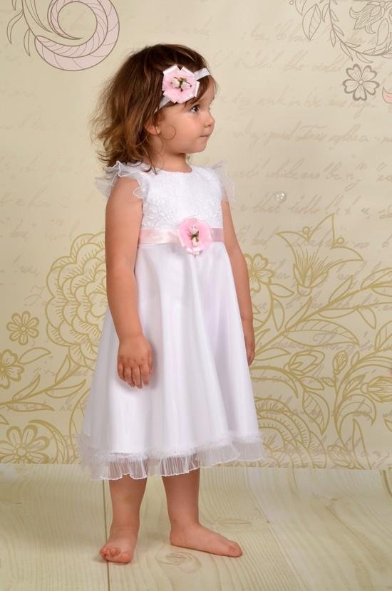 Zwiewna sukienka do chrztu Viviene z koronkową górą i atłasowym dołem.